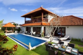 This holiday villa is a 3 bedrooms private villa located south west of Bali near the peaceful Balinese village of Umalas, blessed with a beautiful view, only 5 - 10 min from the trendy Seminyak area. This two-story building is distinguished by its contemporary tropical architecture,providing guests comfort in a stylish and relaxed atmosphere. This holiday rental villa offers a unique Bali experience... from the terrace overlooking the rice fields, relax and enjoy the magical sight of the Bali's mountain range. This rental villa provides an oasis of calmfor singles, couples, families and friends who wantto explore the island of the gods.The accommodation comprise three bedrooms, an open-sided living room with audio visual facilities, a dining room and a fully equipped kitchen. WiFi Internet is accessible throughout the property. This romantic holiday villa rests within a beautiful garden complete with a 12-meters swimming pool, a poolside 'bale' relaxation pavilion, four sun beds, a rattan garden table including comfortable chairs.Service and facilities, Umalas