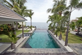 This luxury holiday villa with direct beach access is located on half an hour drive from Lovina, well know for its dolphins. People who are traveling to Bali for diving and snorkeling will love this villa. In front of the rental villa you have some nice spots for snorkeling, and close to the villa is situated a scuba diving resort from where you can make dive trips to the best diving spots from Bali.This holiday villa, situated on a plot of 20 acres with a magnificent spacious tropical garden, is equipped with all western luxuries. The villa contains three bedrooms and a guesthouse with two bedrooms. Each bedroom has air-conditioning, TV and DVD player. From the large infinity pool with jacuzzi you look over the sea, and from where you can enjoy a beautiful sunset. There is even a terrace with disco bar at the waterside. Service and Facilities, Lovina