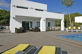 New Villa - modern and comfortable - in Moraira, Costa Blanca, Spain with private pool for 6 people.The villa has a living area of 240m2, terraces 90m2, 800m2 completely fenced plot, its modern style in the home and garden design elements with fruit , Moraira